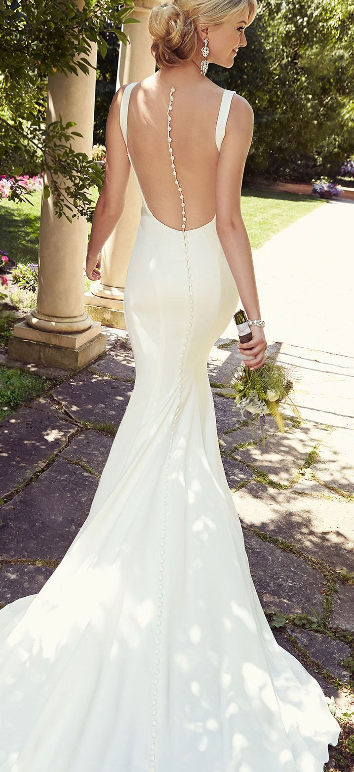 Beautiful slinky wedding gown with a stunning buttoned-down back