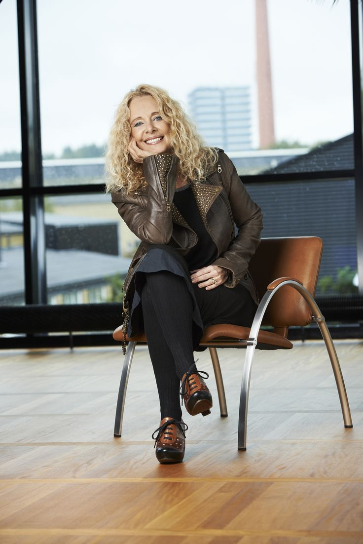 The designer Monica Ritterband sitting in a chairytale chair