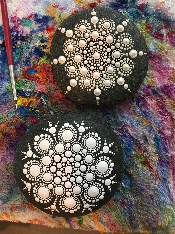 Hand painted mandala stone. Dot painting. Painted rocks.
