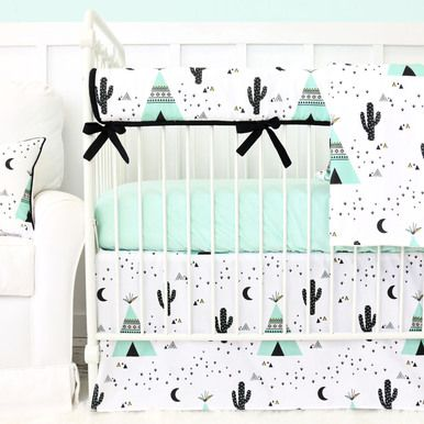 This 2 pc. set features a trendy southwestern print featuring teepees and cacti in mint, black and white. You'll fall in love with the printed flat panel crib skirt and coordinating solid mint crib sheet. This set is perfect for any modern baby boy's nursery!