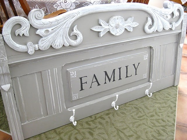 Old headboard repurposed into a coat hanger and family sign.
