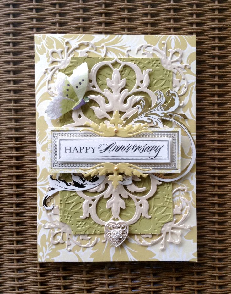 Card by Vickie Blakeslee. Anna Griffin Garden Windows card kit used with Lace Impressions cutting dies and embossing folder for the Cuttlebug.  Miscellaneous heart button and pearls and rhinestone also added.