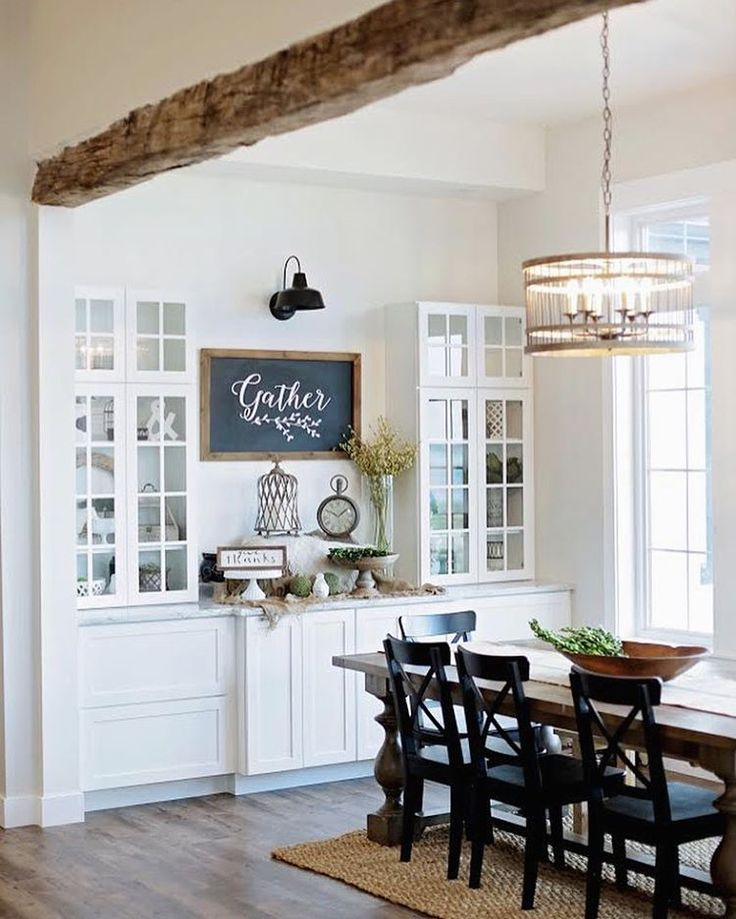 white cabinets, glass front uppers, black accents, and x back chairs for farmhouse style