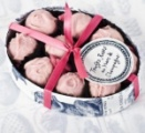 Every mother would love a delicious box of Handmade Marc de Champagne Rose Truffles from Rococo Chocolates London. Packed in a print oval box, these are the ideal Mother's Day gift.