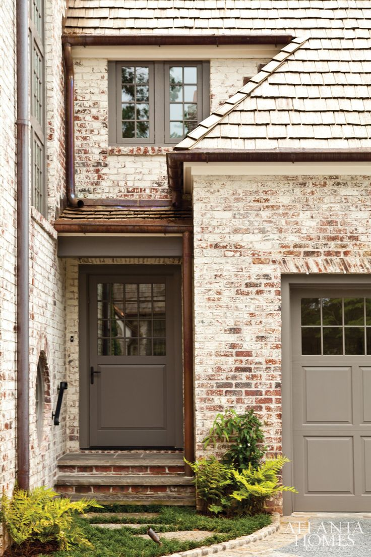 Side entrance of a lime-washed brick residence in Buckhead, Peter Block architect