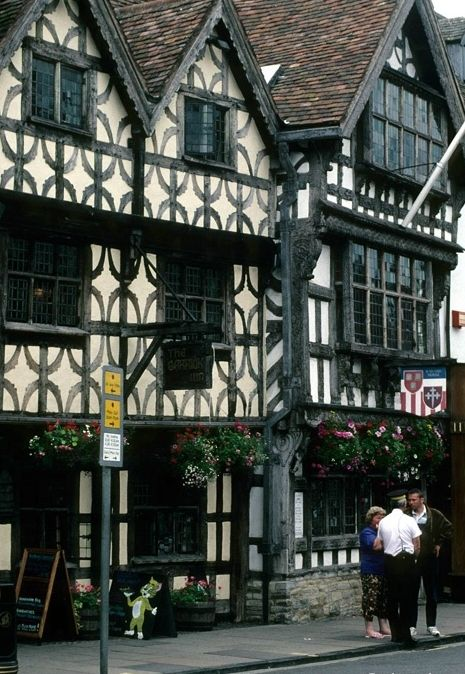 Stratford on Avon, England..The right side has the timbers as part of the structural design..the left looks like a painted design..wonder if this is old or a newer addition?