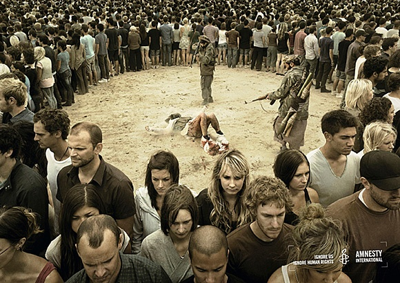 A bit graphic, but the most striking detail is the crowd facing away from what's happening.  I think this is a great example of interpellation, the image calling out to the viewer and catching his/her attention.  The crowd represents the target audience of the advertisement and they convey a strong message--too many people ignore social injustice.  By viewing this picture you are the single individual who is looking at the injustice, so it seems like the image is meant just for you, the…
