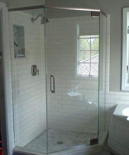 "This Neo-angle Semi-Frameless SHOWERMAN shower enclosure was installed using 3/8"" and ½"" thick, clear tempered glass. To enhance the brilliance of the white ceramic, we used crystal Starphire Glass-- pure & pristine! Notice the height of the shower door is custom cut to the height of the tile. You can count on our shower design team to take the time to perfect every last detail-- backed by our 15 year guarantee!"