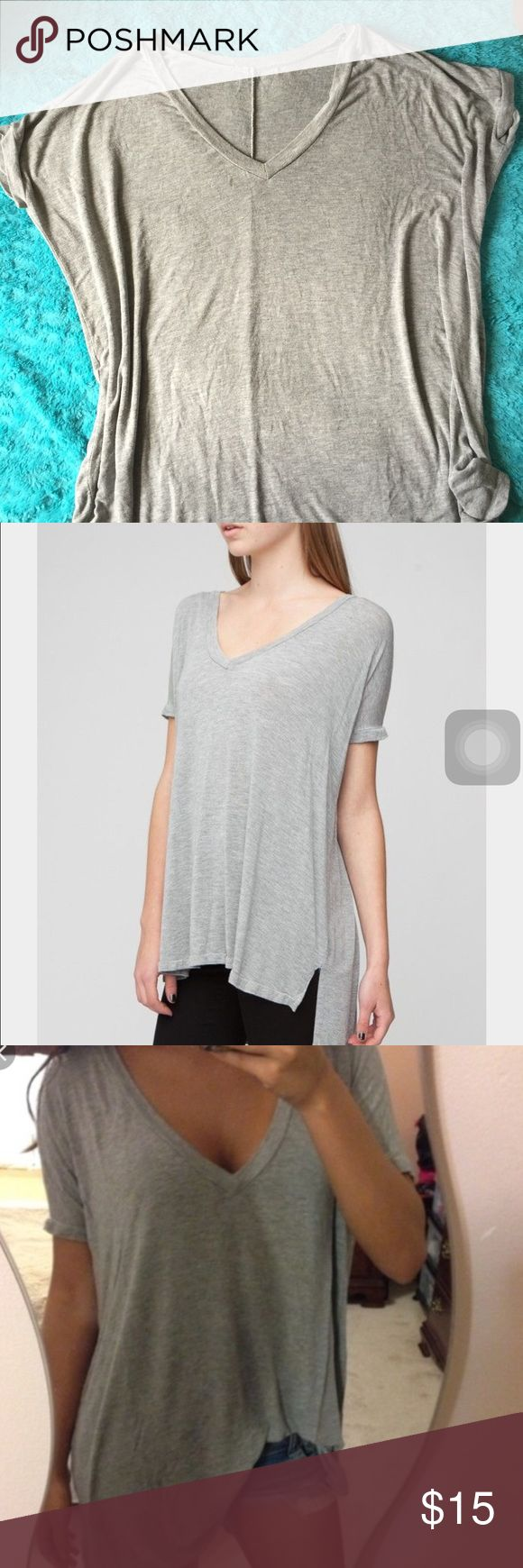 Brandy Melville Milan Top Cute light grey, only flaw is that the Brandy Melville tag fell off after puting it in the wash, really cute and Flowy Brandy Melville Tops Tees - Short Sleeve