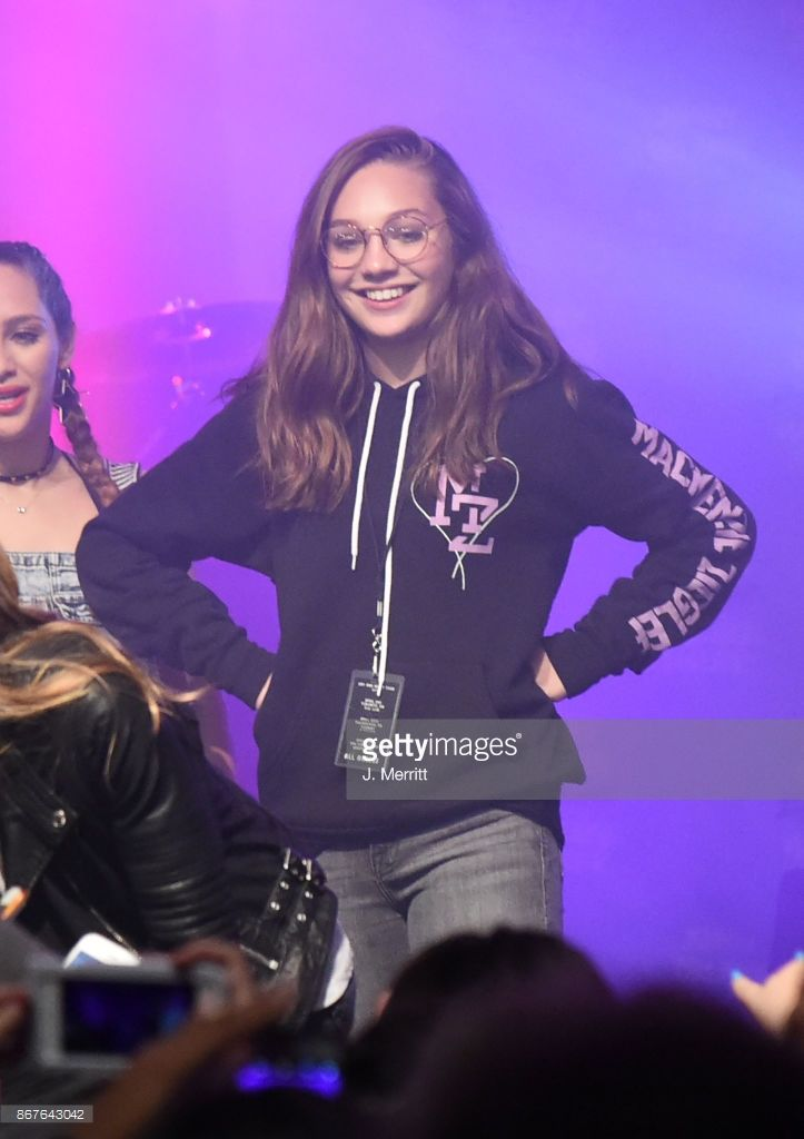 Maddie Ziegler is seen celebrating on stage after Johnny Orlando & Mackenzie Ziegler perform during their 'Day & NIght' tour at Mr Smalls on October 28, 2017 in Millvale, Pennsylvania.