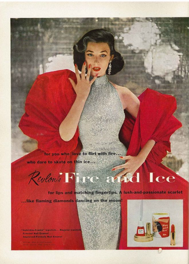 Dorian Leigh in a silver sleeveless turtleneck sheath w/a red pouf evening coat/ad for Fire and Ice