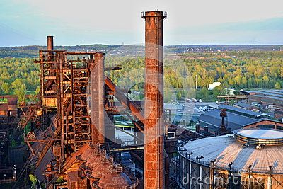 Abandoned ironworks factory - rusty chimney sunlit by the sun, national monument Lower Vitkovice, Ostrava, Czechia