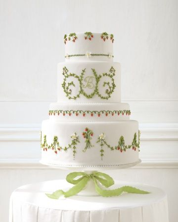 Sweet fruit designs and a piped monogram make this cake berry nice for summer weddings.