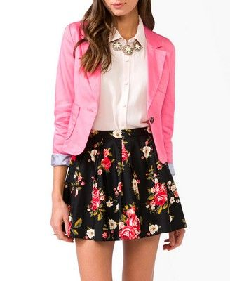 skirt with A-line at waiste  tucked in collared shirt  bright popping blazer  flats