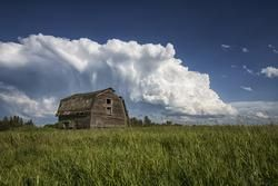 supercell with large hail behind barn in Saskatchewan