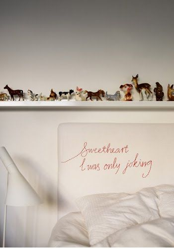 Embroidered note on a headboard - totally wonderful x