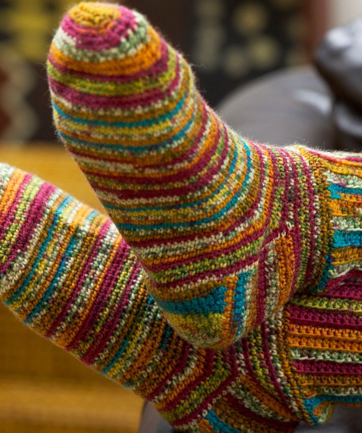 Gonna give these a try...I want to do what they say can not be done well by crochters. Colorful Crochet Socks
