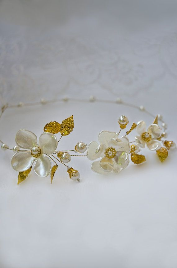 Look at this... its gorgeous!   https://www.etsy.com/au/listing/238868876/pearl-crown-tiara-gold-flower-crown