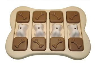 Lady also has this interactive puzzle -if you remove the bones, there are treat compartments underneath, but they have to be removed for the dog to slide the outer blocks towards the center for additional treat compartments!