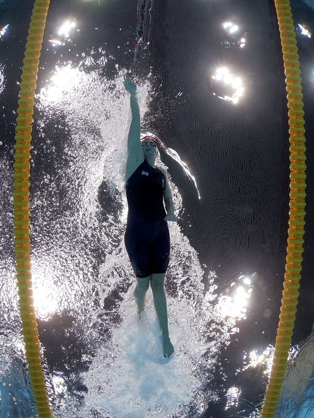 """<b>The London Aquatic Center's pool camera captures a unique perspective of Olympic swimmers racing for gold.</b> (All the images are courtesy of the best Olympic-focused Twitter account: <a href=""""http://go.redirectingat.com?id=74679X1524629&sref=https%3A%2F%2Fwww.buzzfeed.com%2Fstacylambe%2F8-photos-of-olympics-swimmers-spotted-from-below&url=https%3A%2F%2Ftwitter.com%2FL2012PoolCam&xcust=1701376%7CBFLITE&xs=1"""" target=""""_blank""""><b>@L2012PoolCam</b></a>.)"""