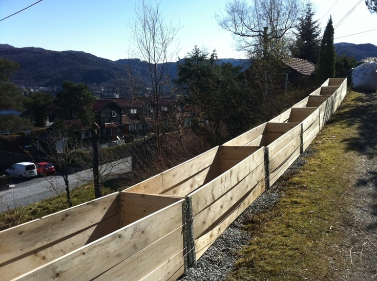 Long row of pallet collar raised garden beds - in the making