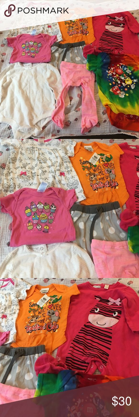 Baby 👶🏻 girl or boy clothes lot 6 months Lot of baby girl or boy clothes! 6 months! Can mix and match. 2 are new with tags and the rest are new just dry cleaned. New with tags items are the rainforest cafe and the m&m onesies. They retail for $15 and $17 each! Bought at the price! Matching Sets