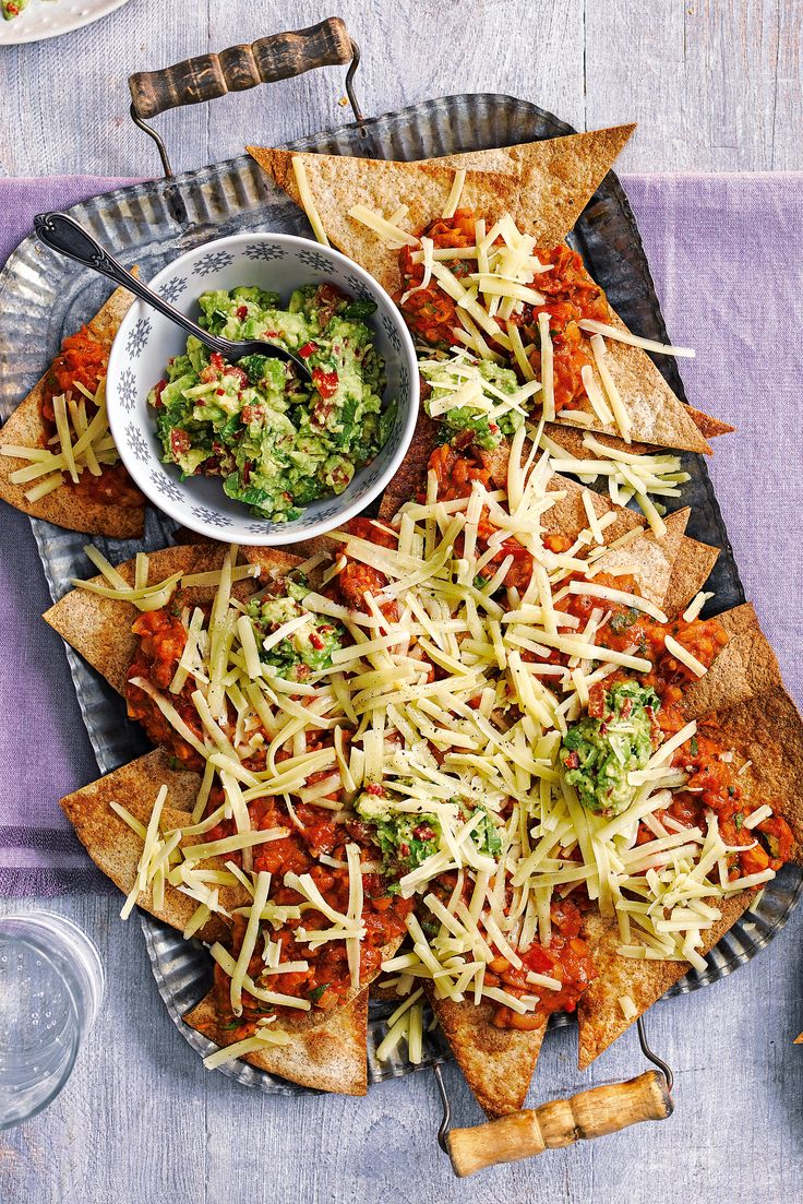 This family favourite features crisp tortillas, spicy mixed beans, homemade avocado salsa and plenty of mature Cheddar - an easy nachos recipe that takes just over half an hour to make, but is sure to be devoured in minutes. | Tesco