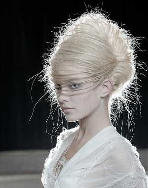 an avant-garde look from Angelo Seminara.  The subjects were backlit intentionally so that the fly-aways create a halo effect.