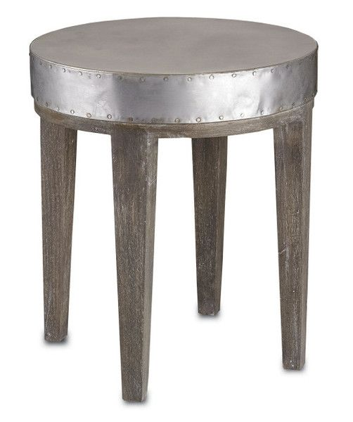 Wren Table by Currey & Co. With a nod to both industrial and chic references, this small accent table has a round metal top with rivet details around the edges.