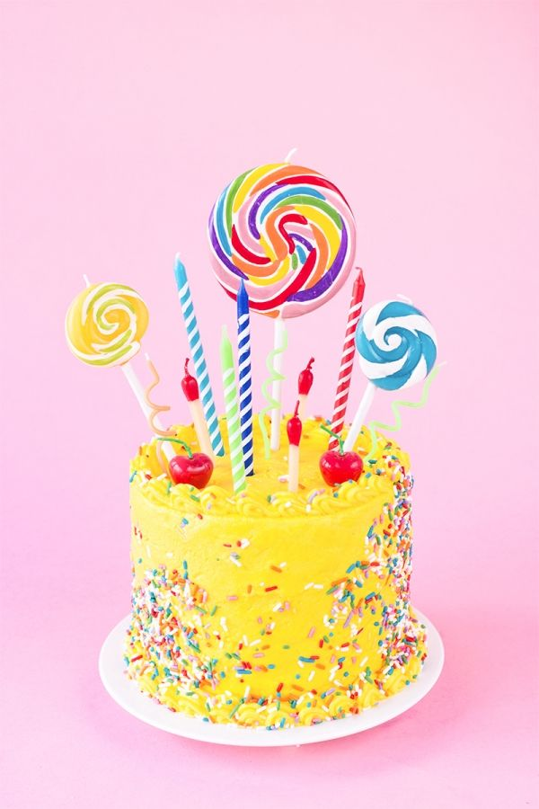 Birthday candles and lollipops cake topper.