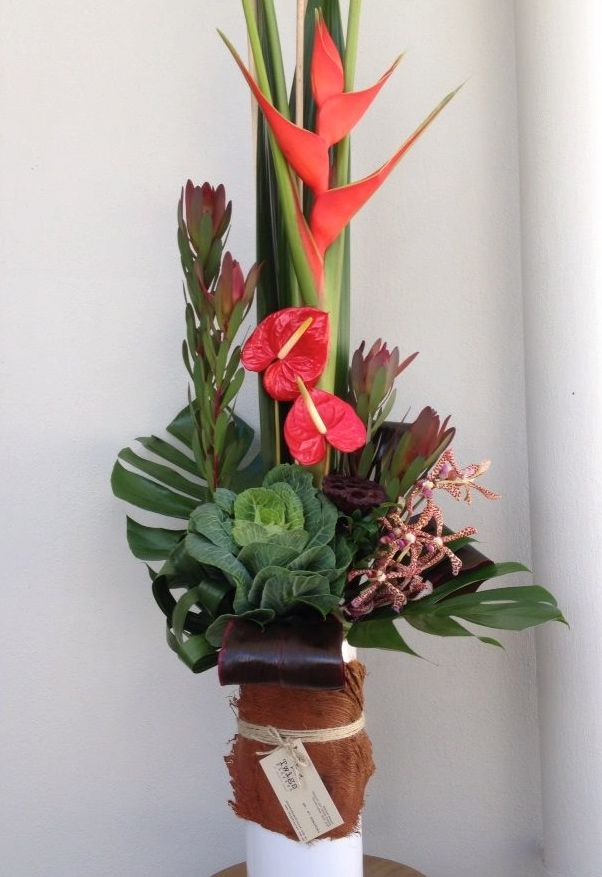 Corporate flowers for reception at a law firm, long lasting tropicals flowers and kale.