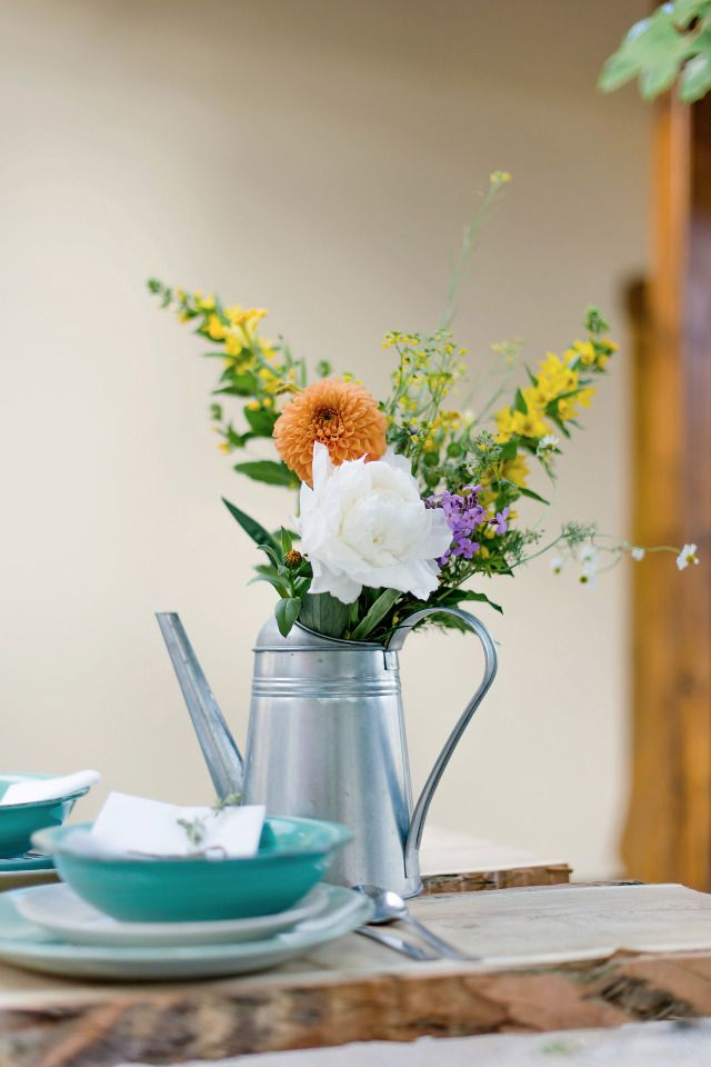watering can floral centerpiece