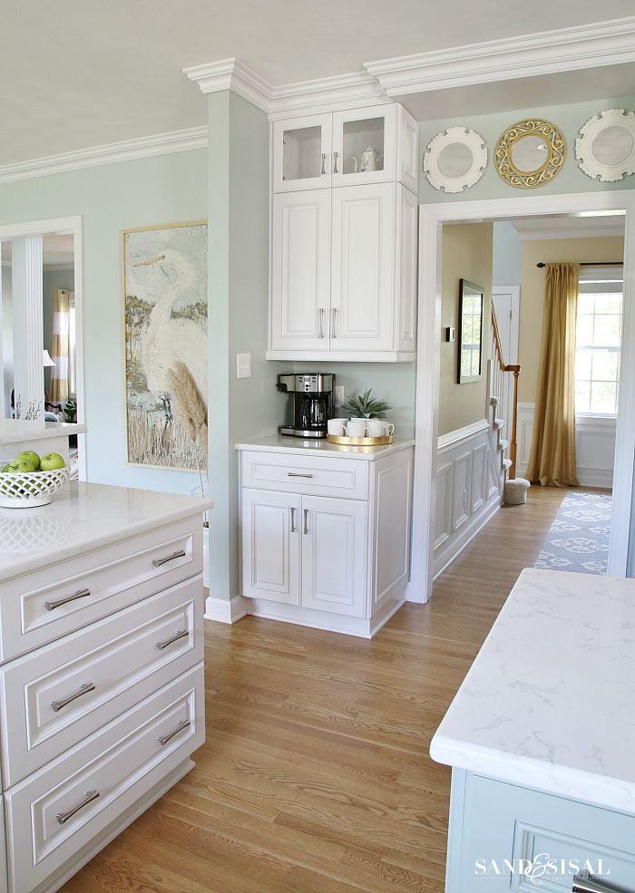 kitchen walls- Sherwin Williams Comfort Gray family room walls – Sherwin Williams Sea Salt white cabinets – Sherwin Williams (custom white color) but closest would be Extra White island color – Sherwin Williams Oyster BayCoastal Kitchen Home Tour