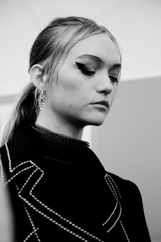Winged eyeliner on Gemma Ward backstage at Prada SS15 MFW. More images here: http://www.dazeddigital.com/fashion/article/21773/1/prada-ss15-live-stream