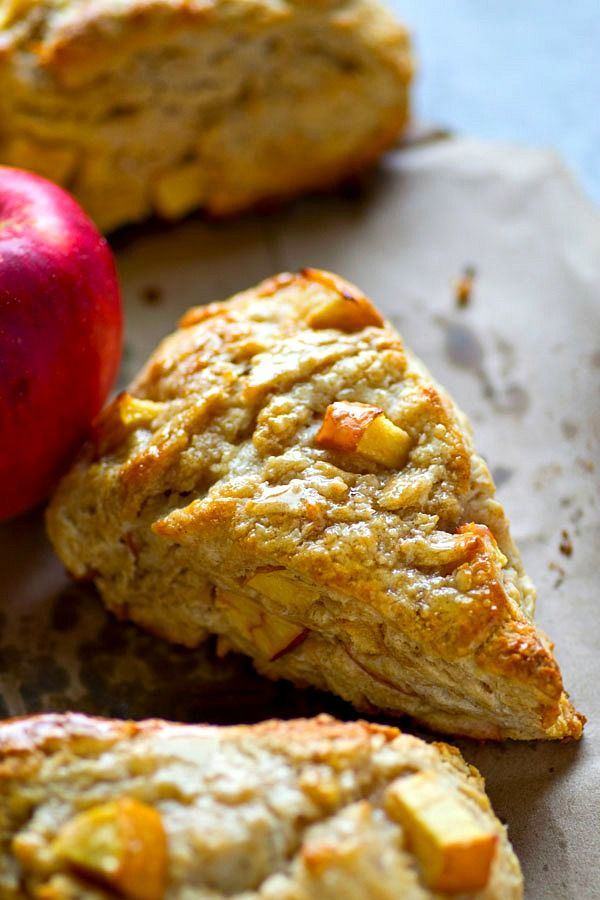 Cream cheese makes these beautiful apples scones SO flaky inside and maple syrup adds just the right touch of fall.---These scones are the best fall breakfast straight outta the oven!