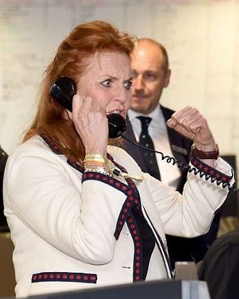 Fergie, Duchess of York flexes her verbal muscles on the phones at Canary Wharf