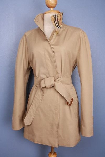 This is a 100% genuine Burberry Trench Coat, customized by our master tailor to a Modern Short Trench Coat. Including the Burberry check to the back on the collar which looks fantastic when collar is turned up. More vintage Burberry coats in variable sizes and colors available in our shop. Use code Pinterest10 for a 10% discount on this coat at check out.