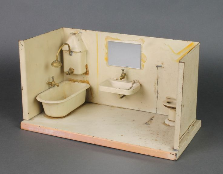 "Lot 244, A pressed metal model dolls house insert of a bathroom with bath geyser, hand basin and lavatory, the hand basin, geyser and bath all with cisterns 6""h x 12""w x 7""d, est £30-50"