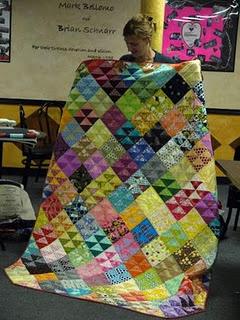 Great way to showcase lights and darks.I live this. I think this is how I want to do my tshirt quilt