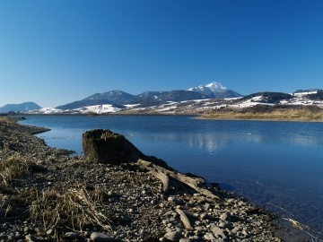 Water Reservoir Besenova (lake below Liptovska Mara Dam) in Liptov region, Slovakia. Peak of mount Choc can be seen in distance.