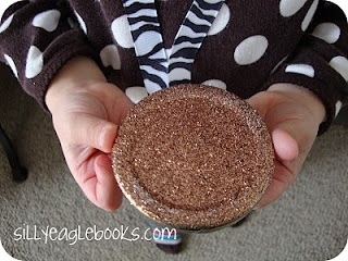 Olympic medals for kids to make. Use jar lids and glitter or metallic paint.