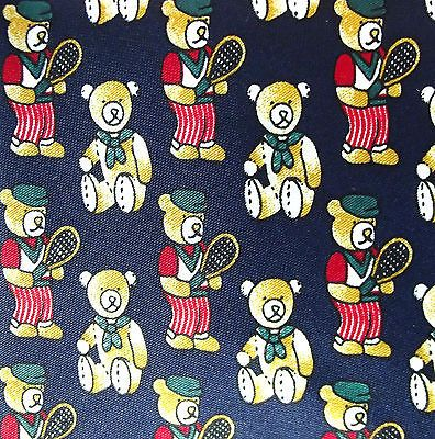 A novelty silk tie by Charlize with a whimsical sporting theme - teddy bear tennis players Navy blue Korean silk with teddy print Condition Excellent