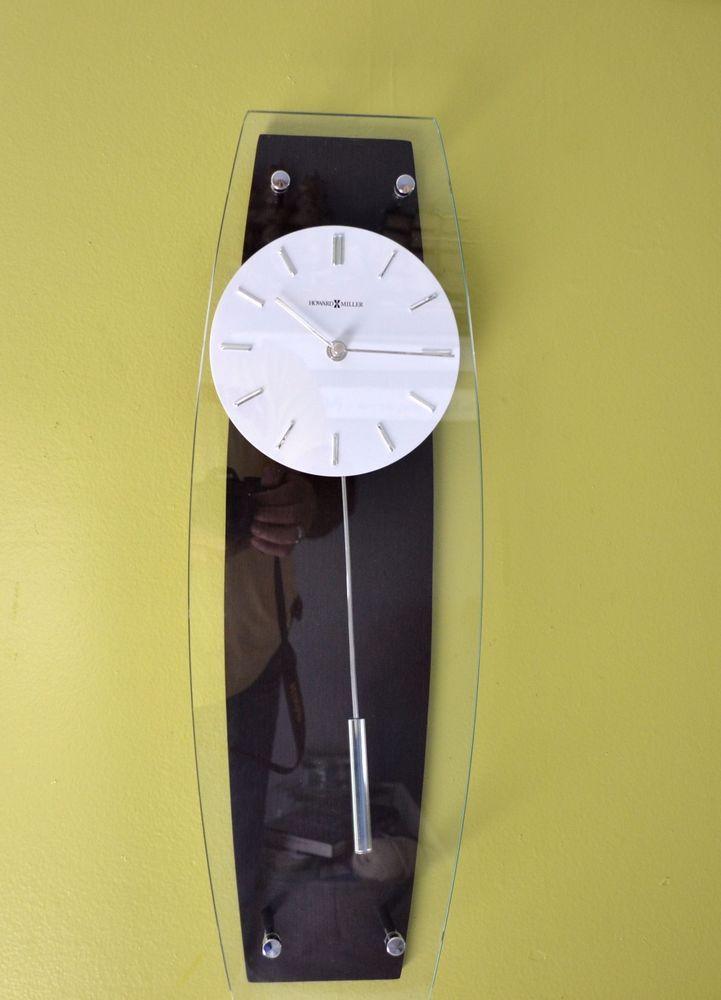 Howard Miller 625 401 Cyrus Wall Clock Glass Wood Brown 23 X 7 5 X 2 75 Wall Clock Glass Wall Clock Clock
