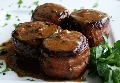 Pork Tenderloin In Garlic Sauce | Pork tenderloin is becoming increasingly more popular, and this is a dish I recently had at a restaurant that I just had to create at home. The tenderloin is cut into medallions, rolled in cracked pepper, and then cooked in Marsala wine. It is topped by an easy sauce or gravy made with garlic.