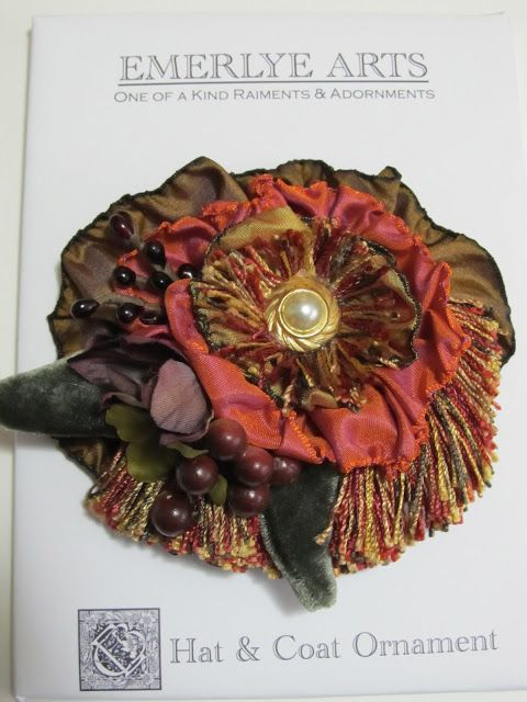 This ribbonwork pin is made from ribbon, velvet, vintage earring, fringe, flowers & berries. Yum.