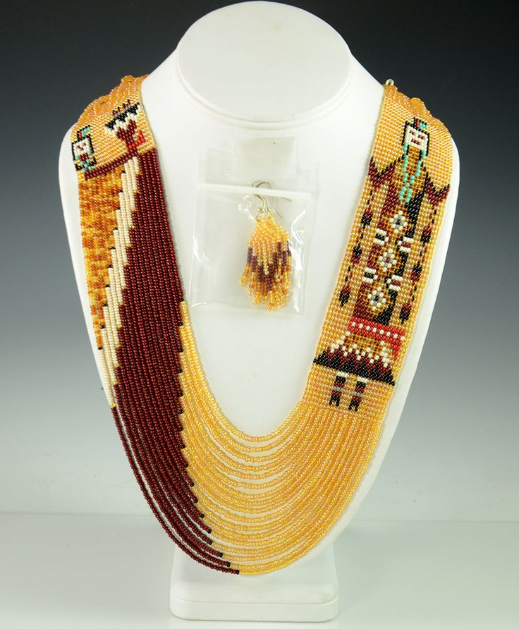 """-- INQUIRE -- ITEM NUMBER: NEC7083 ARTIST: Rena Charles TRIBE: Navajo DIMENSIONS: Measures 32"""" long and 1-1/2"""" Wide MORE DETAILS: Eye-catching Navajo Beade"""