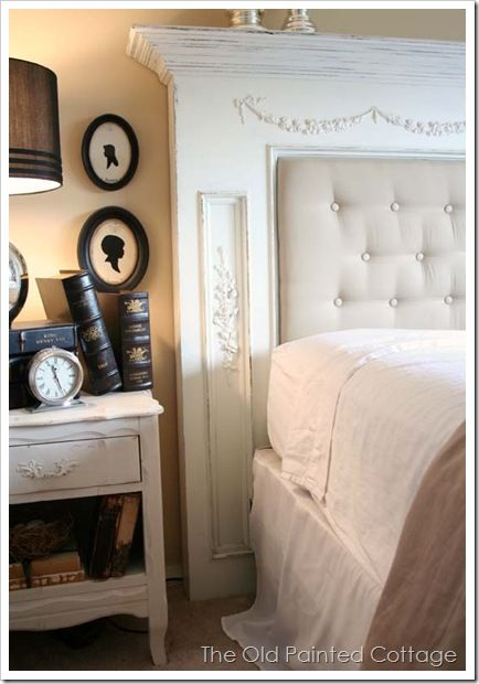 Old fireplace mantle painted and made into a headboard!  Awesome!