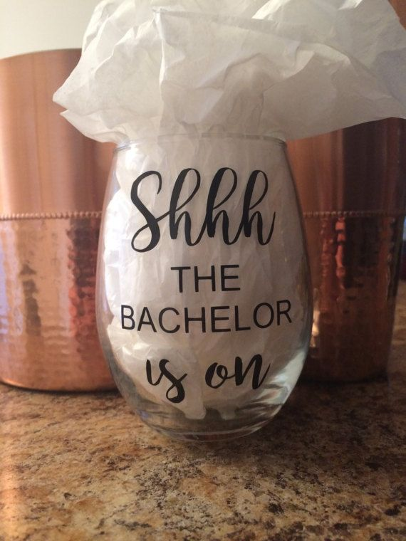 Will this stemless wine glass accept your rose?! Get ready for your favorite show with this funny glass featuring the words Shhh The Bachelor Is On in premium, outdoor grade vinyl in black. Not a fan of The Bachelor? Not a problem! This can be made with ANY show title that youd like! Just let me know in the note to seller if you want a different show and Ill be happy to customize it for you!  All glasses are HAND-WASH ONLY!  As always, feel free to contact me for custom orders