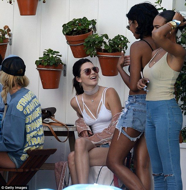 White hot! Kendall Jenner, 20, donned a plunging cutout tank as she watched her friend Jus...