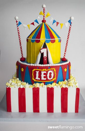 "This week little Leo is turning 1! His cake was created to for the party's Carnival theme - sculpted sugar flags, a tent and even ""popcorn""!  Happy birthday Leo!    Cake: Butter Yellow  Filling: Chocolate Ganache  Frosting: Chocolate Ganche & Milk Chocolate Fudge Buttercream    Thanks to  heatherscakes for the inspiration!"